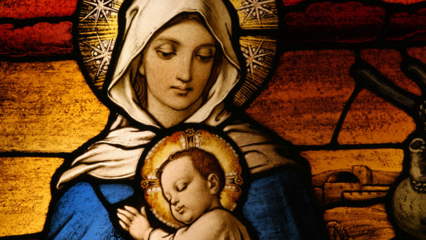 Stained glass depicting the Virgin Mary holding baby Jesus
